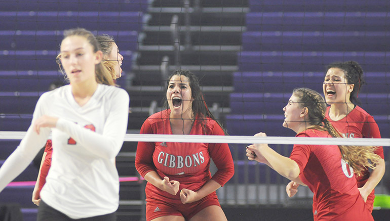 Cardinal Gibbons players Valeria Rosada (1), Fabiana Capone (6) and Dylan Andrews celebrate a point during the fourth game of the FHSAA Class 4A volleyball state final match Nov. 15, 2020 at Suncoast Credit Union Arena in Fort Myers. Bishop Kenny defeated Cardinal Gibbons 29-27, 25-18, 17-25, 25-20 to win their third state title.