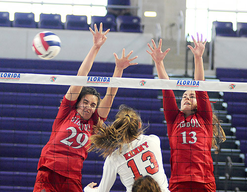 Cardinal Gibbons blockers Emma O'Keeffe (29) and Jessica Cinci (13) block Bishop Kenny's Ashton Dilts during their FHSAA Class 4A volleyball state final match Nov. 15, 2020 at Suncoast Credit Union Arena in Fort Myers. O'Keeffe had five blocks, and Cinci had four blocks. Bishop Kenny defeated Cardinal Gibbons 29-27, 25-18, 17-25, 25-20 to win their third state title.