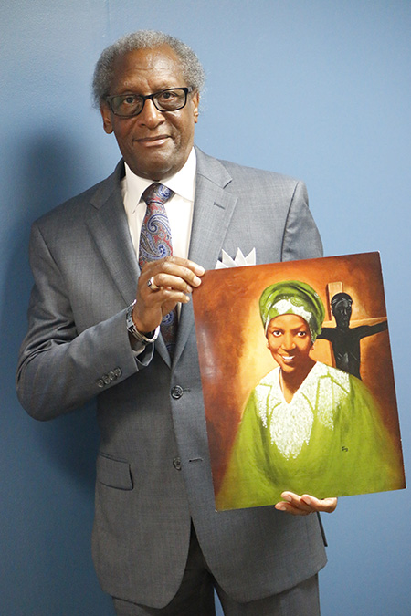 Donald Edwards, associate superintendent of schools for the Archdiocese of Miami, poses with an image of his good friend, now Servant of God Sister Thea Bowman.