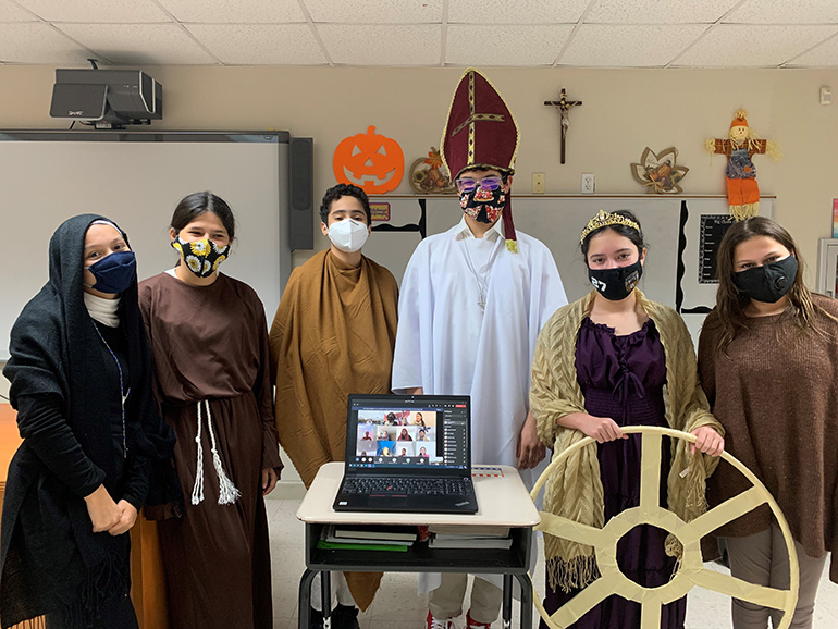 Eighth graders from Mother of Our Redeemer School show off their saint costumes to mark the feast  of All Saints, as their classmates learning from home also take part. The display took place Nov. 2, 2020.