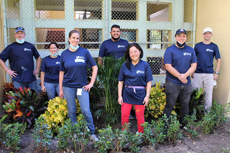 Volunteers from Hancock, Askew and Co. pose in the garden they helped plant at Catholic Charities of the Archdiocese of Miami's Notre Dame Child Development Center in Little Haiti, Nov. 5, 2020. From left are Craig Armstrong, Solanghe Rodriguez, Vanessa Barrera, Anthony Perez-Florido, Adriana Kambe, Adrian Fresnedo and Javier Serpa. The accountants and auditors at Hancock, Askew and Co. participate twice a year in community service projects across the state. In addition to planting a garden, they also cleaned and painted part of the entrance wall, and the playground.
