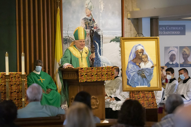 Archbishop Thomas Wenski preaches the homily during the Mass celebrating the feast day of St. Martin de Porres, Nov. 8, 2020. The Mass took place at St. Augustine Church in Coral Gables, and marked the start of Black Catholic History Month. Next to the archbishop is an image of the Black Madonna with child.