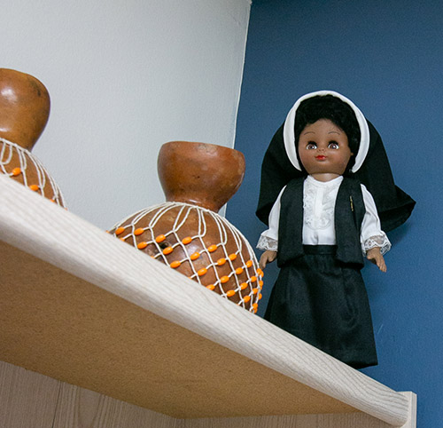 A doll of an Oblate Sister of Divine Providence adorns the office of Katrenia Reeves-Jackman, director of the archdiocesan Office of Black Catholic Ministry. Mother Mary Lange, who founded the order, is on the road to canonization. The Oblates were the first religious community for women of African descent.