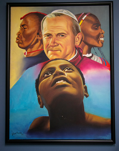 This painting, commemorating St. John Paul II's visits to Africa, hangs on the office wall of Katrenia Reeves-Jackman, director of the archdiocesan Office of Black Catholic Ministry.