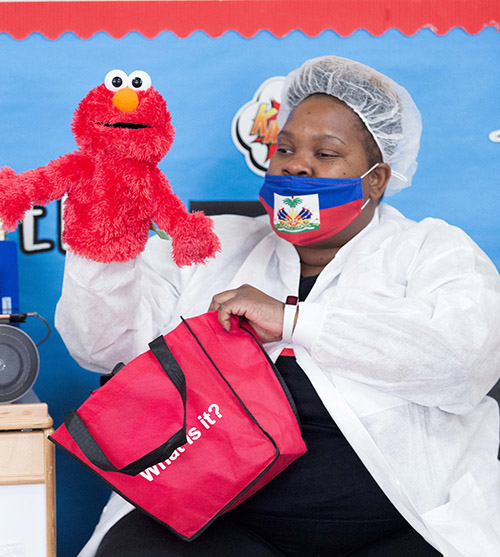 A staff person teaches while wearing personal protective gear at the Head Start and Early Head Start program at Holy Redeemer Church in Miami, one of six such programs throughout Miami-Dade County operating at reduced in-class capacity during the COVID-19 global pandemic.