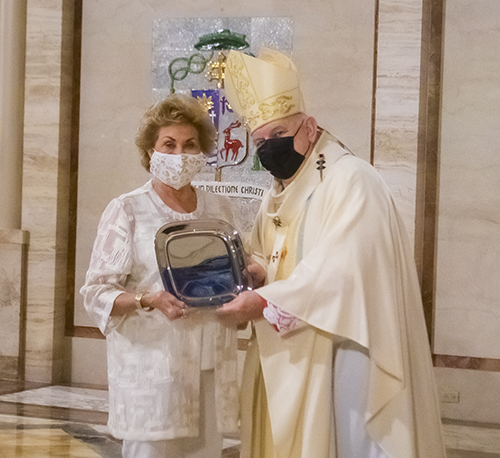 Archbishop Thomas Wenski gives Sandy McCarthy the One in Charity award during the Thanks-for-Giving Mass celebrated at St. Mary Cathedral, Nov. 21, 2020.