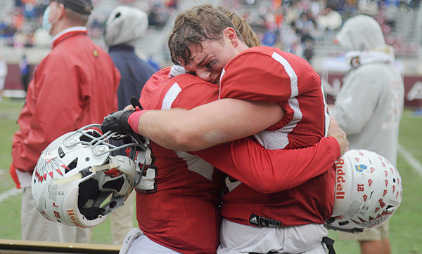 Cardinal Gibbons seniors Brody Palhegyi and William Spicer celebrate Cardinal Gibbons' 35-21 victory over Jacksonville Bolles on Thursday, Dec. 17, 2020, in the Class 4A FHSAA State Football Championship Game at Bobby Bowden Field at Doak Campbell Stadium in Tallahassee.