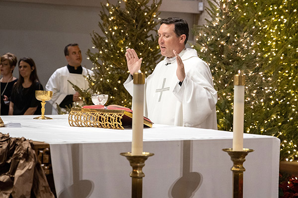 Father Richard Vigoa, pastoral administrator of St. Augustine Parish in Coral Gables, who recovered from a bout of COVID-19 in March of this year, presides at a wedding at the end of 2019.