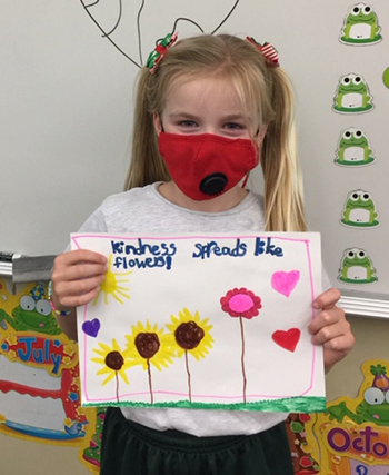 A student shows her take on how kindness spreads after taking part in Mary Help of Christians School's Anti-Bullying Week, Nov. 16-20, 2020.