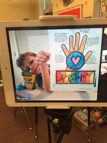 """A student, learning online, shows his drawing of Pope Francis' """"Five Finger Prayer"""" during Mary Help of Christians School's participation in Anti-Bullying Week, Nov. 16-20, 2020."""