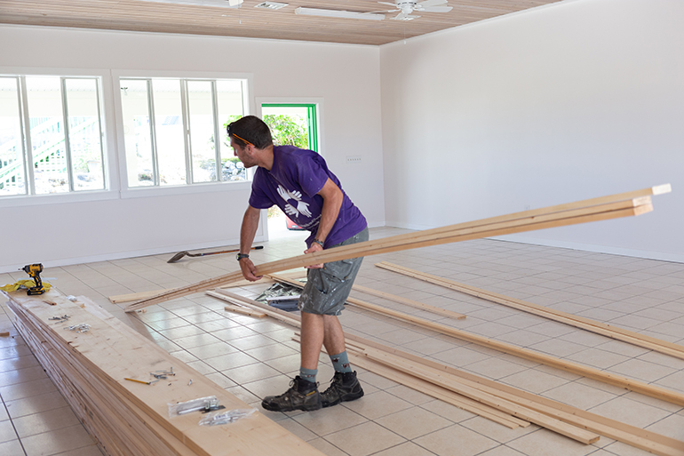 International volunteers make preliminary repairs last February at St. Francis de Sales School in Abaco, which was closed following last year's devastating Category 5 Hurricane Dorian.