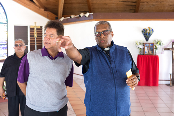 At St. Francis de Sales Church in Abaco, Nassau Archbishop Patrick Pinder led a delegation of Archdiocese of Miami Catholic Charities senior staff on a post-Hurricane Dorian tour of key locations on Feb. 19-21, 2020. With him were Peter Routsis-Arroyo, left, CEO of Miami's Catholic Charities, and Msgr. Roberto Garza, board chairman for Catholic Charities Miami. Catholic Charities is now facilitating the disbursement of a $ 340,000 grant for rebuilding awarded by Catholic Charities USA.