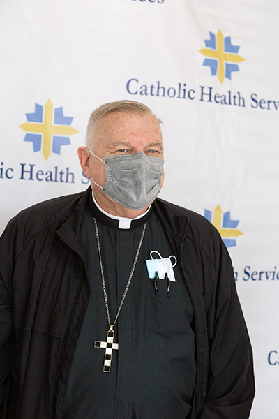 Archbishop Thomas Wenski waits to receive one of the first doses of a COVID-19 vaccine when Florida state public health officials rolled it out Dec. 16, 2020 at St. John's Nursing Center in Fort Lauderdale, part of Catholic Health Services of the Archdiocese of Miami. Staff and residents of the facility were offered the Pfizer-BioNTech COVID-19 vaccine, which the U.S. Food and Drug Administration authorized for emergency use Dec. 11, 2020.