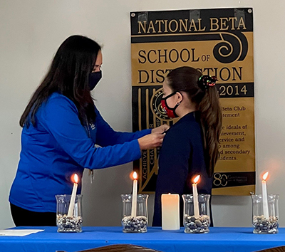 Mother of Our Redeemer School in Miami inducted 19 of its students into the National Beta Club during a ceremony Dec. 16, 2020. Some of the inductees participated in person, others virtually.