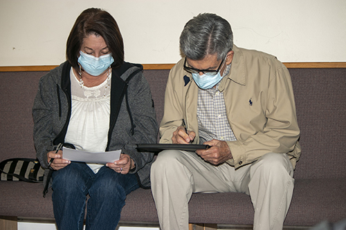 Elizabeth and Dagoberto Rodriguez, 75 and 79 respectively, fill out health information before getting the Moderna COVID-19 vaccine at their parish, San Lazaro in Hialeah, Jan. 20, 2021.