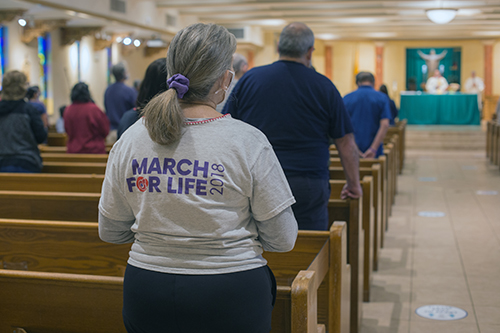 Blessed Trinity parishioners and others celebrate Mass before taking part in a Prayer Walk For Life along Curtiss Parkway in Miami Springs, Jan. 23, 2021.