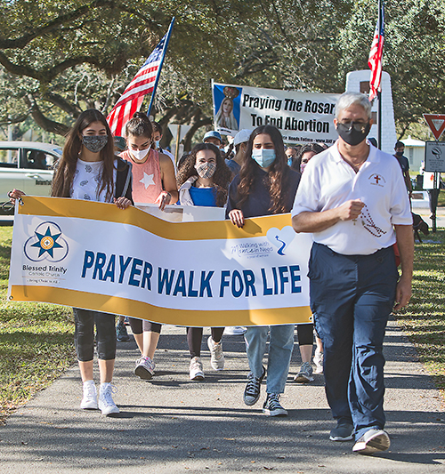 Blessed Trinity Deacon Ernie Sosa leads participants in the Prayer Walk For Life, Jan. 23, 2021, along Curtiss Parkway in Miami Springs.