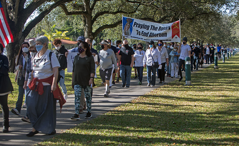 Blessed Trinity parishioners and others take part in a Prayer Walk For Life along Curtiss Parkway in Miami Springs, Jan. 23, 2021.