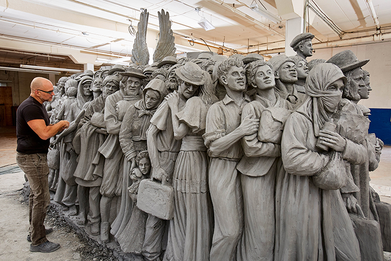 "Sculptor Timothy Schmalz works on ""Angels Unawares,"" which will be shown in Miami February 2021."