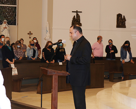 Father Israel Mago, pastor of Our Lady of Guadalupe Church in Doral, prays with parishioners at the start of the informational session on Deferred Enforced Departure for Certain Venezuelans, which took place Jan. 27, 2021.