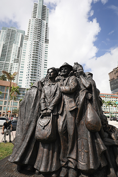 The Angels Unawares sculpture sits in a corner of Bayfront Park, surrounded by the tall buildings of downtown Miami Feb. 10, 2021. The sculpture, a tribute to migrants and refugees, will remain at the park through April 8, 2021.