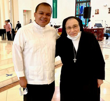Salesian Sister Yamile Saieh is shown here with Father Elvis Gonzalez at her farewell Mass in September 2020. The two became good friends when he was director of the Office of Vocations and she served on the Vocations Board, screening would-be seminarians.
