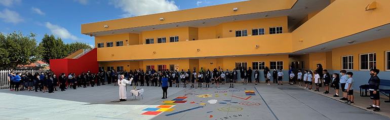 Students gather in the large courtyard at Mother of Our Redeemer School in northwest Miami-Dade County to receive their ashes in a socially distanced way, Feb. 17, 2021.