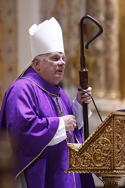 Archbishop Thomas Wenski preaches his homily while celebrating Ash Wednesday Mass at Miami's historic Gesu Church, Feb. 17, 2021.