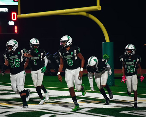 St. Brendan High players get off the field during an Oct. 23, 2020 game against Somerset Academy South Homestead, which St. Brendan won 48-7.