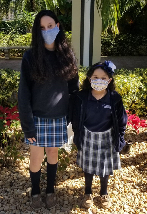 """Eighth grader Savanah Riveron and first grader Ana Chavez are St. Jerome School's 2021 """"students of the year,"""" chosen by the Fort Lauderdale school's faculty and staff."""