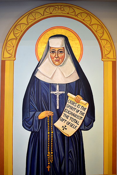 The patroness of St. Katharine Drexel Church stands to the right of the chancel. The 19th century educator combined prayerfulness with ministry to the disadvantaged.