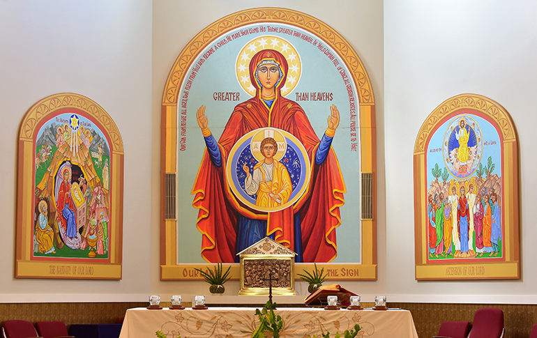 Three icons share the chancel area at St. Katharine Drexel Church. The central double icon, Our Lady of the Sign, is based on the belief that while Mary was pregnant with Jesus, her womb itself was a holy sanctuary.