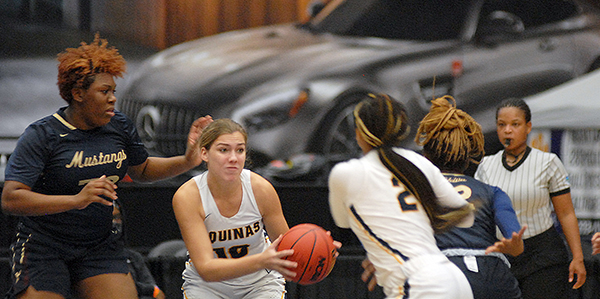 St. Thomas Aquinas' Dakota Degenhardt (10) grabs a rebound in the final seconds of the second quarter of St. Thomas Aquinas' 62-60 victory over Wekiva in the FHSAA Class 6A girls basketball championship game Saturday, Feb. 27, 2021, at the RP Funding Center in Lakeland. Degenhardt passed to Breanna Gustave, who hit a 3-pointer that cut the Raiders' deficit to 31-30 at halftime. The Raiders won their first championship.
