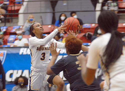 St. Thomas Aquinas senior Samara Spencer (3) goes for a layup against Wekiva defenders during the third quarter of St. Thomas Aquinas' 62-60 victory over Wekiva in the FHSAA Class 6A girls basketball championship game Saturday, Feb. 27, 2021, at the RP Funding Center in Lakeland. Spencer had 17 points to help the Raiders win their first championship.
