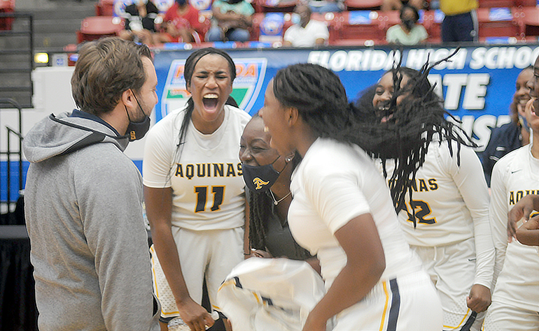 St. Thomas Aquinas coach Oliver Berens fires up his team in celebration after their 62-60 victory over Wekiva in the FHSAA Class 6A girls basketball championship game Saturday, Feb. 27, 2021, at the RP Funding Center in Lakeland. The Raiders won their first championship.