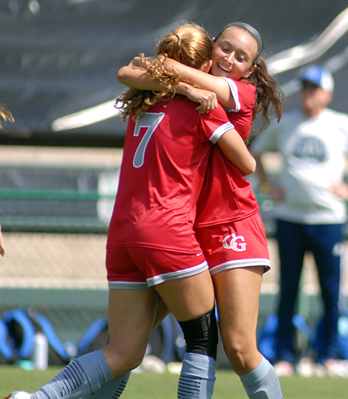 Cardinal Gibbons freshmen Samantha Fuini and Julianna Torres (7) celebrate Fuini's goal in the first half of Cardinal Gibbons' 2-0 victory over Panama City Beach Arnold in the FHSAA Class 4A girls soccer championship game March 3, 2021, at Spec Martin Stadium in DeLand. The Chiefs won their first girls soccer championship.