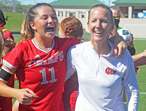 Senior Heather Astle, left, and coach Margo Flack celebrate Cardinal Gibbons' 2-0 victory over Panama City Beach Arnold in the FHSAA Class 4A girls soccer championship game March 3, 2021, at Spec Martin Stadium in DeLand. The Chiefs won their first girls soccer championship.