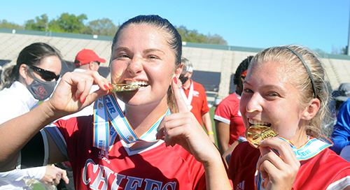 Senior Heather Astle, left, and junior Erin Pawelczyk perform the bite test on their gold medals while celebrating Cardinal Gibbons' 2-0 victory over Panama City Beach Arnold in the FHSAA Class 4A girls soccer championship game March 3, 2021, at Spec Martin Stadium in DeLand. The Chiefs won their first girls soccer championship.