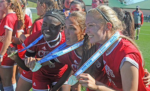 From left, Senior Deborah Bien-Aime, senior Madison Rivard and junior Erin Pawelczyk show off their gold medals after Cardinal Gibbons' 2-0 victory over Panama City Beach Arnold in the FHSAA Class 4A girls soccer championship game March 3, 2021, at Spec Martin Stadium in DeLand. The Chiefs won their first girls soccer championship.