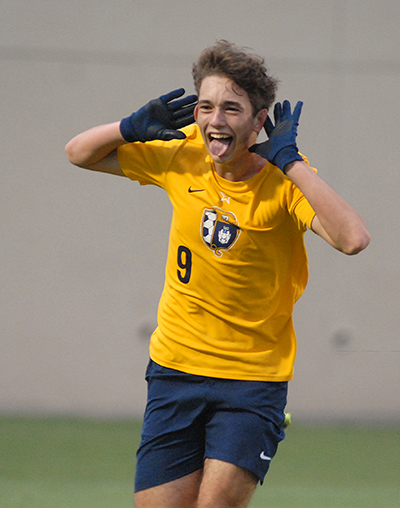 Belen Jesuit's Matias Perinot celebrates his tying goal during the second half of the Belen Jesuit Wolverines' 2-1 overtime victory over the Tampa Jesuit Tigers, March 6, 2021 in the FHSAA Class 5A Boys Soccer Championship Game at Spec Martin Stadium in DeLand.