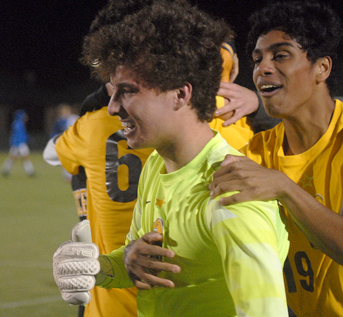 Goalkeeper Jack Volpe, left, and Collin Pallissery celebrate the Belen Jesuit Wolverines' 2-1 overtime victory over the Tampa Jesuit Tigers, March 6, 2021 in the FHSAA Class 5A Boys Soccer Championship Game at Spec Martin Stadium in DeLand.