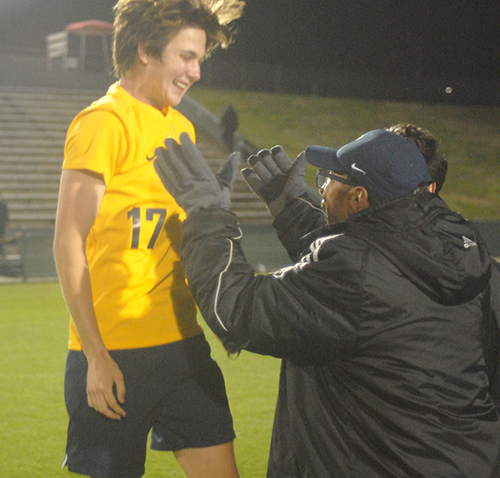 Belen Jesuit sophomore Lucas Monge (17) leaps into the arms of Wolverines head coach Tanger Mendonca after their 2-1 overtime victory over the Tampa Jesuit Tigers, March 6, 2021 in the FHSAA Class 5A Boys Soccer Championship Game at Spec Martin Stadium in DeLand.
