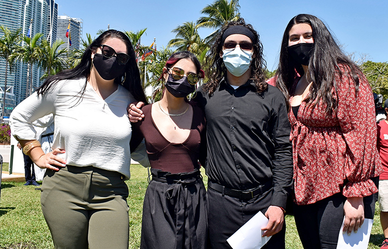 Barry University students attend the announcement of the university's new Institute for Immigration Studies. From left are Isabella Acanda, Angie Rodriguez, Andrés Sanchez and Gigi Rios.