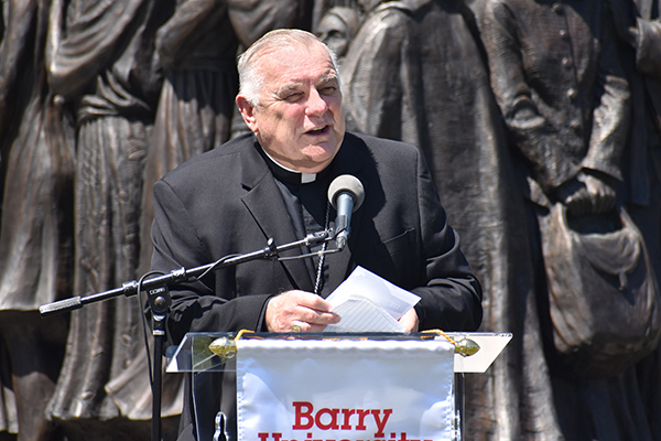 """""""The immigrant is a stranger to be embraced as a brother or sister,"""" Archbishop Thomas Wenski says during the announcement of Barry University's new Institute for Immigration Studies."""