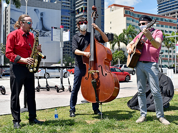 The Barry University Faculty Jazz Trio provided music before and after the announcement of the university's new Institute of Immigration Studies.