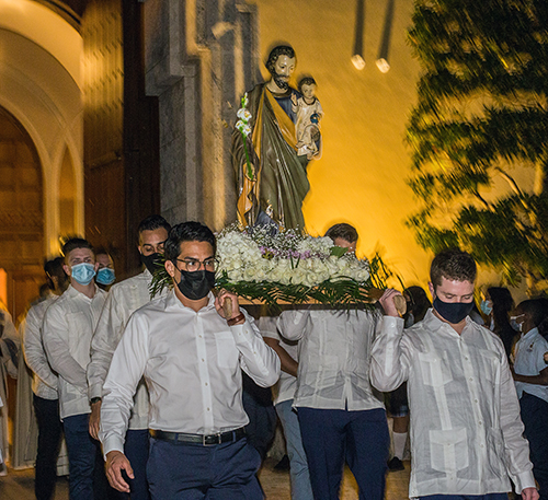 Brian Ayala, Cody Nelson, Anthony Paz and Ray Camacho carry a statue of St. Joseph out of St. Mary Cathedral to Northwest Second Avenue where a short procession took place on his feast day, March 19, 2021.