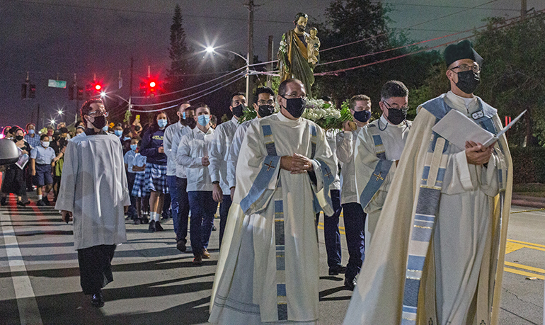 Father Christopher Marino, rector of St. Mary Cathedral, leads the procession with the statue of St. Joseph through the streets surrounding the church to mark the Year of St. Joseph on his feast day, March 19, 2021.