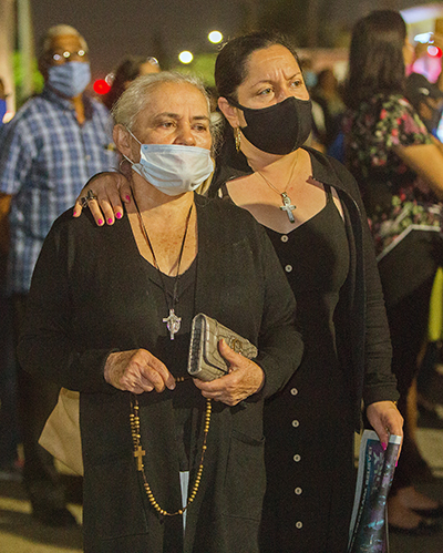 Sonia Cristancho walks in procession with her mother, Maria Cristancho, during the procession on the streets surrounding St. Mary Cathedral which took place on St. Joseph's feast day, March 19, 2021.
