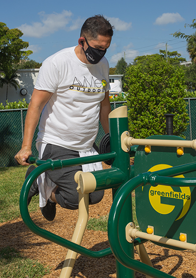 Alejandro, a client, uses one of the outdoor fitness devices donated by AvMed during Fit 'n Trim day at Camillus House, March 24, 2021.