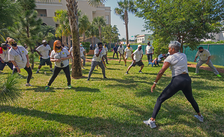 Shebah Carfagna, a health, wellness and fitness instructor with Panache Fitness Company, leads Camillus House clients in exercises during Fit 'n Trim day, March 24, 2021.